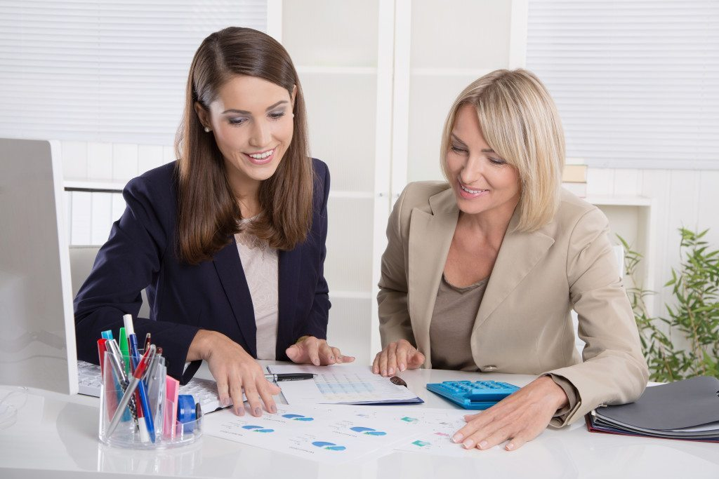 Team of successful businesswoman in the office: concept for equal rights or woman in leading positions.